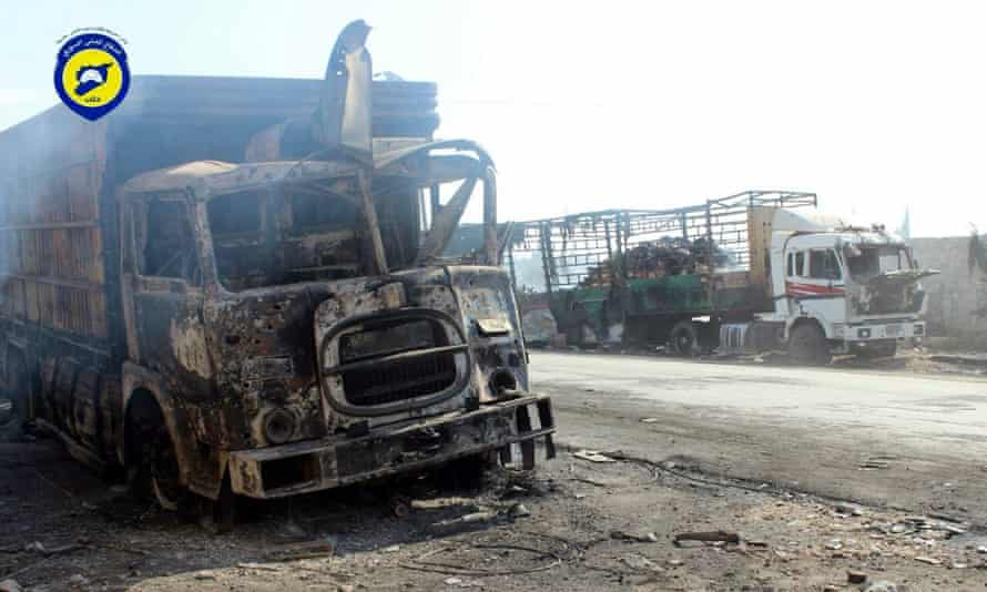 A picture made available by Syria Civil Defence volunteer group shows destroyed trucks from the aid convoy that was bombed in an airstrike a day before.