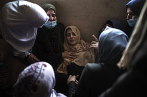 Beit Hanoun, Gaza. Relatives of 11-year-old Hussain Hamad, killed by an explosion during the latest violence between Israel and Hamas, mourn in the family home