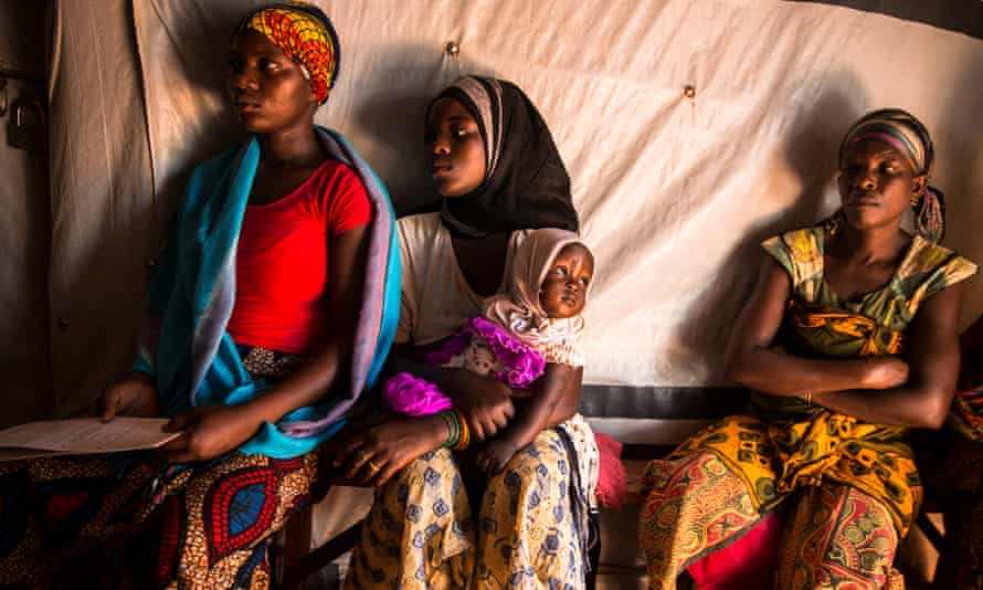 Women wait in the IRC women's centre at the Nyarugusu refugee camp in Tanzania.