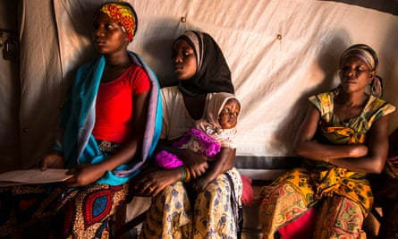 Women wait in the IRC women's centre at the Nyarugusu refugee camp in Tanzania.