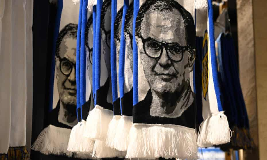 Marcelo Bielsa scarves for sale outside Leeds' Elland Road stadium. The manager has disciples across the world and uses them to assist him.