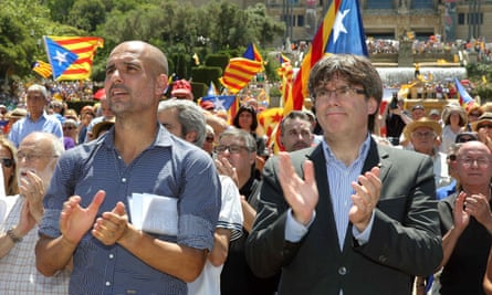 The Manchester City manager, Pep Guardiola, left, and the Catalan regional president, Carles Puigdemont, at the rally in Barcelona.