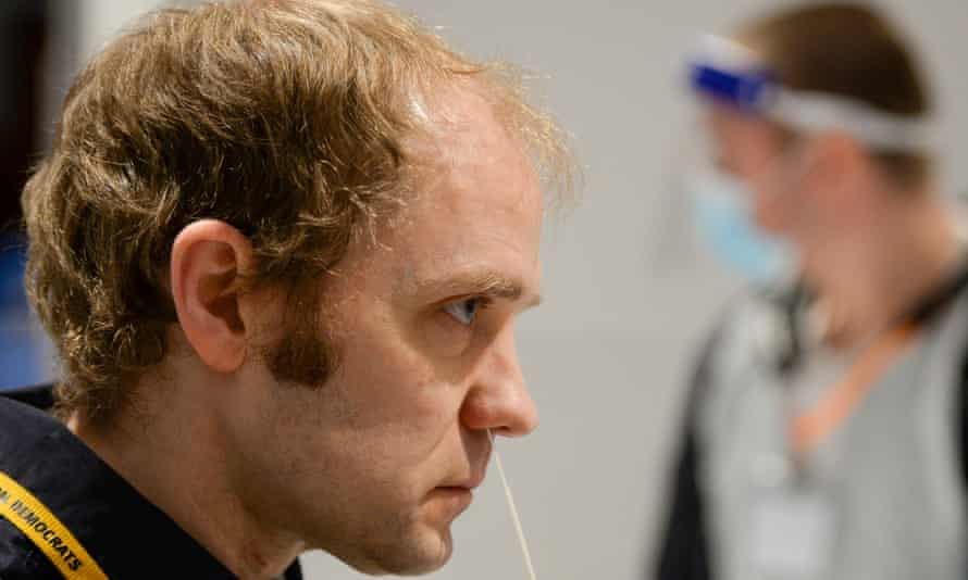 Test swab inserted into man's nose