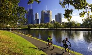 Cyclists Yarra River and CBD Melbourne Victoria Australia