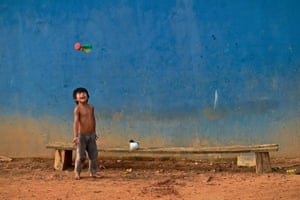 A boy plays with a peteca shuttlecock in Piaracu village, Mato Grosso, Brazil