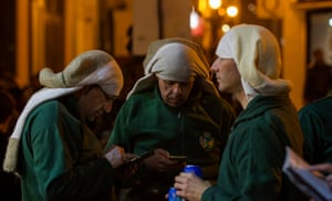 Taking a break during the madrugá (early morning) Good Friday procession in Seville, Andalucia