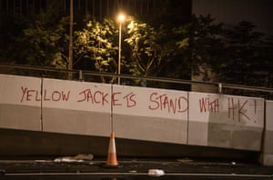 Pro-democracy graffiti on a wall after the 16 September protest march