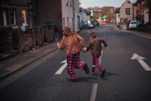 Children running across a road