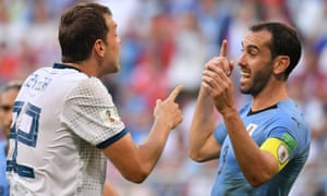 Uruguay's Diego Godin (R) argues with Russia's Artem Dzyuba during a Russia 2018 World Cup match.