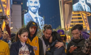 Fans gather to mourn Bryant outside his NBA home, the Staples Center in Los Angeles, on Sunday night.