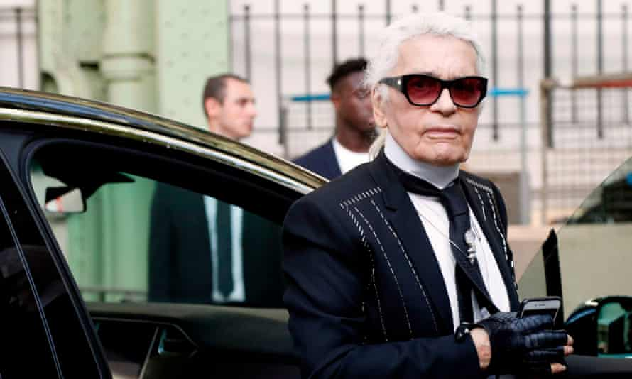 German fashion designer Karl Lagerfeld gets out of a car