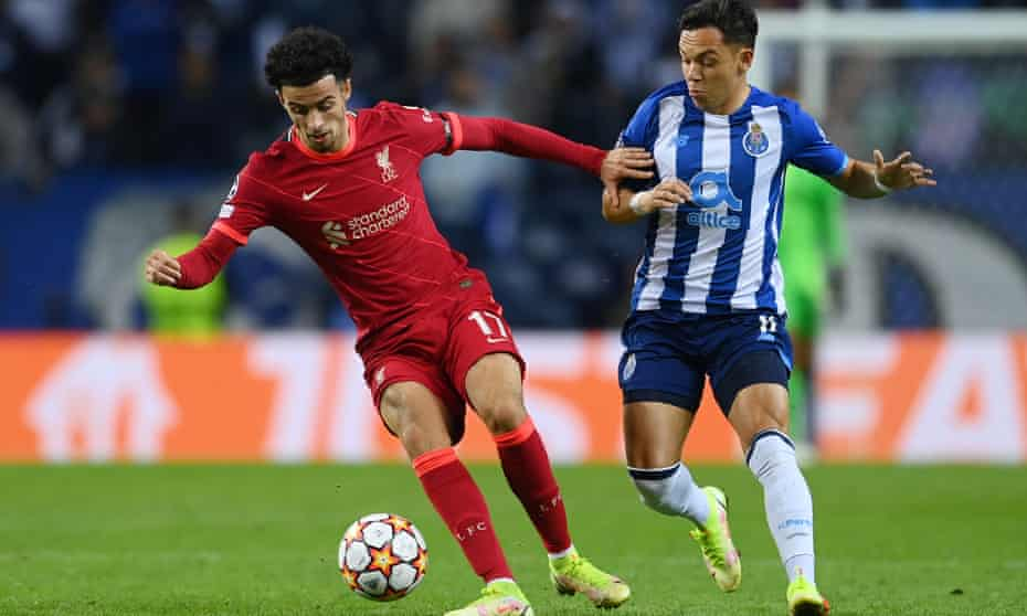 Curtis Jones holds off Porto's Pepe during Liverpool's 5-1 Champions League win on Tuesday.