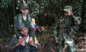 Guerrilla fighters of the Farc's Bloque Magdalena Medio relax as their leaders prepare to sign a historic deal to end their 52-year war.