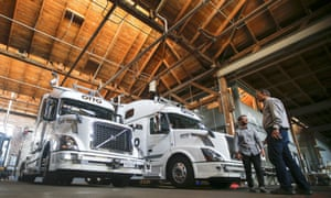 Employees stand next to self-driving, big-rig trucks at the Otto headquarters in San Francisco. Uber bought Otto for an estimated $680m.