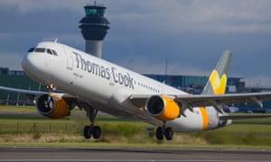 A Thomas Cook plane takes off