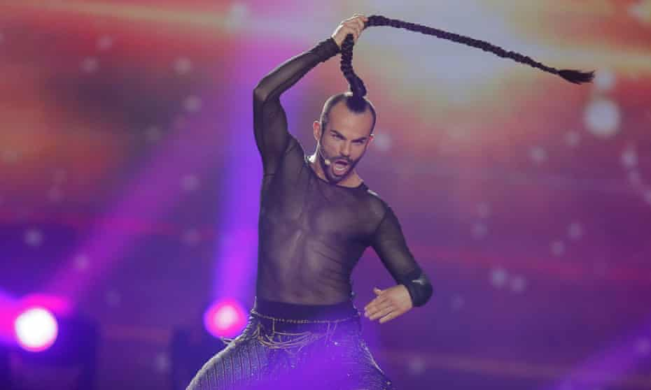 Is there anything that can undermine 'the integrity and non-political nature of Eurovision'? … Montenegro's Slavko Kalezic performs Space.