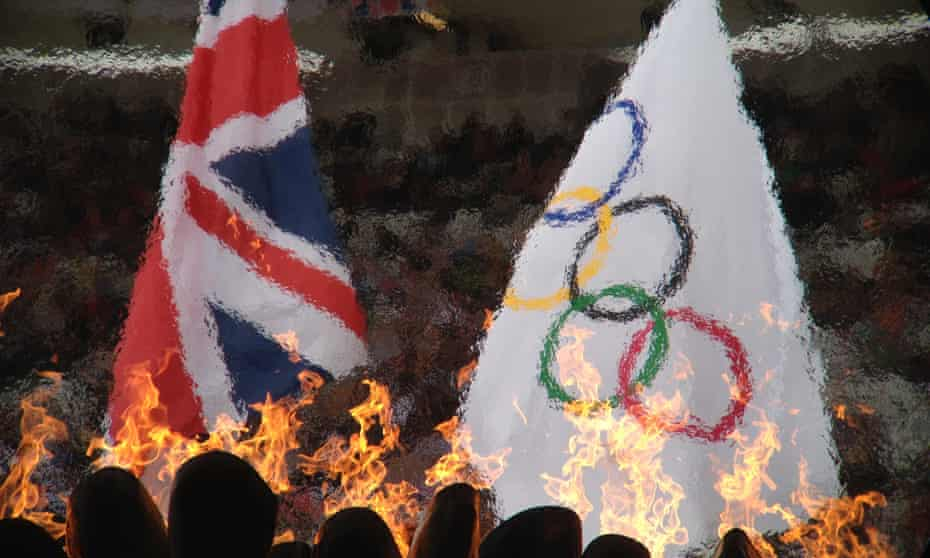 The union jack and the Olympic flag fly above the flames in the stadium this morning