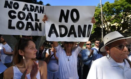 Environmental activists voice their opposition to Indian mining company Adani's proposed Carmichael coal mine, outside Parliament House in Brisbane, Australia, 25 May 2017.