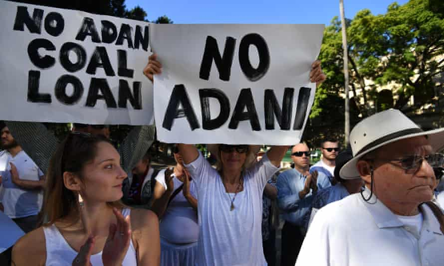 Environmental activists voice their opposition to Adani's proposed Carmichael coalmine outside Parliament House in Brisbane on 25 May.