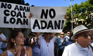 Environmental activists protest in Brisbane against Adani's proposed Carmichael coal mine. Steve Ciobo blames activists for preventing Australia's retail banks from financing 'otherwise viable exporters in the coal sector'