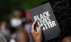 A demonstrator holds a card that reads 'Black lives matter' in Georgia
