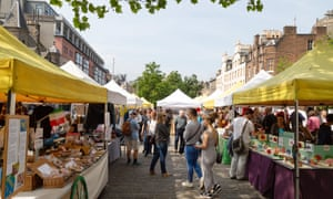 People shopping in the weekly market, Grassmarket, Edinburgh