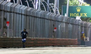 A man walks on the track during the Singapore Grand Prix