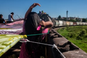 Andrea, 14, brushes her hair. A man living across the railroad tracks offered up his house for those in the caravan to shower while the train stopped, but only momentarily.