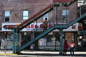 People walk up and down a staircase in East New York