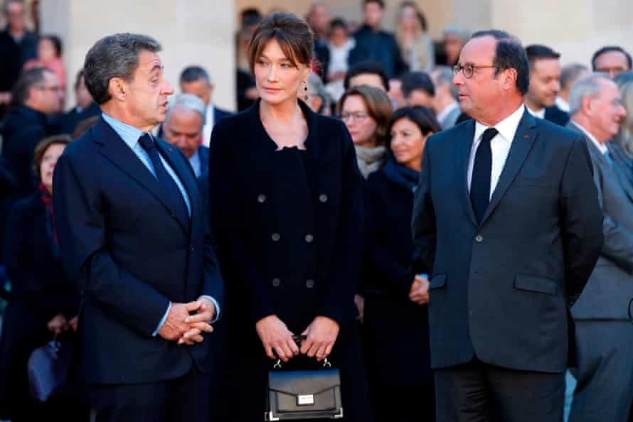 Former French presidents Nicolas Sarkozy (left) and François Hollande, with Sarkozy's wife, Carla Bruni.
