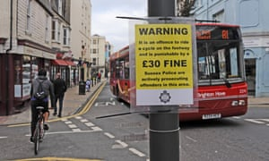A sign warns cyclists of a £30 fine for cycling on the pavement in St James's Street, Brighton.