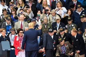 Donald Trump and President Emmanuel Macron greet war veterans