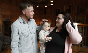 Lilly Ross holds her 17-month-old son Leonard as she talks with face transplant recipient Andy Sandness.