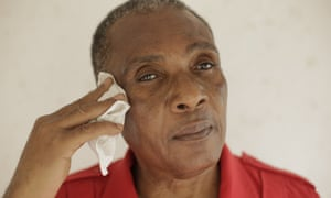 ken boothe looking relaxed and holding a handkerchief in his right hand