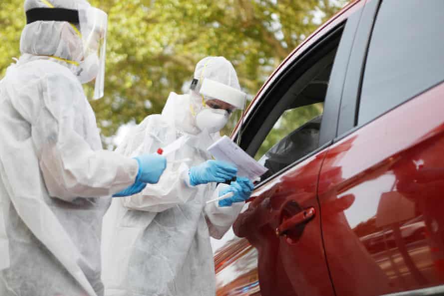 Healthcare workers administer coronavirus testing in Tampa, Florida.