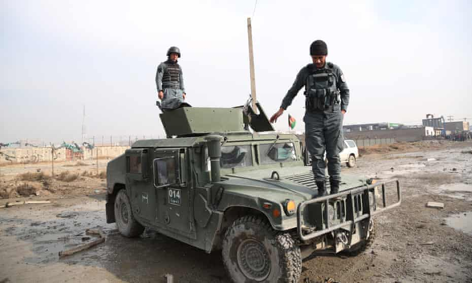 Staff members of Afghan security force inspect the blast site in Kabul, Afghanistan, on 29 November. Taliban militants organized a deadly car bomb attack in the Afghan capital on Wednesday night.
