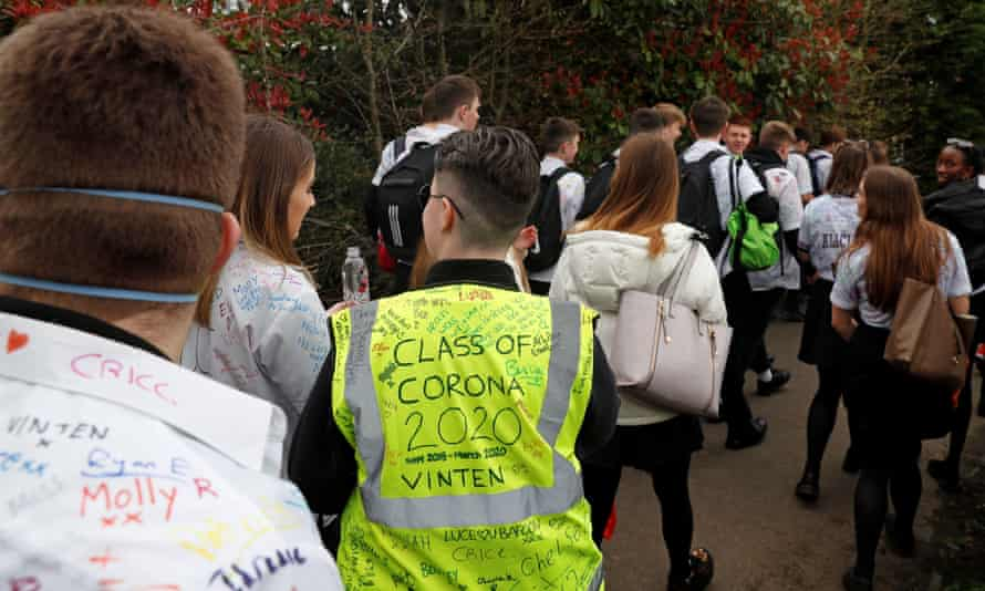 Year 11 pupils, some with graffiti-covered shirts, leaving school unexpectedly earlier this year as schools began to close