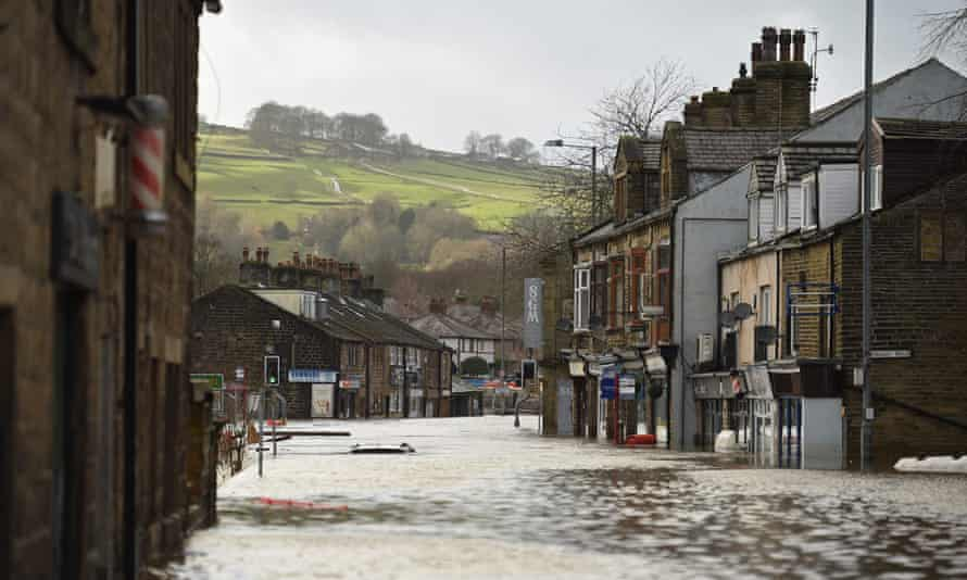 A car is submerged as flood water covers roads in Mytholmroyd, northern England.