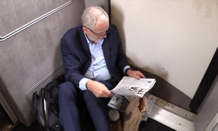 A still from the video of Jeremy Corbyn sitting on the floor of a train.