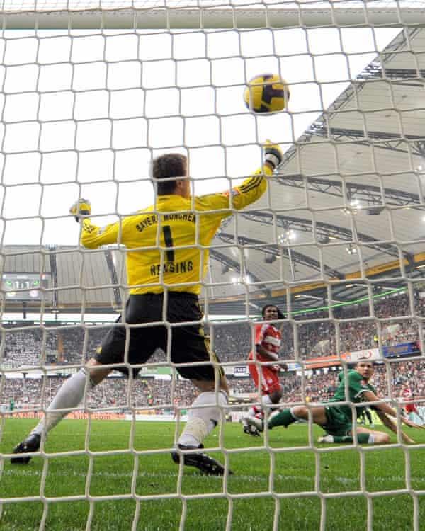 Edin Dzeko scores past Bayern keeper Michael Rensing in April 2009.