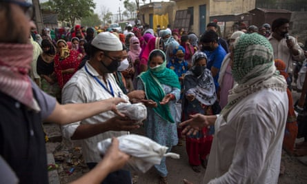 Muslims distribute food to the poor and needy in the Mustafabad area, which was recently affected by riots