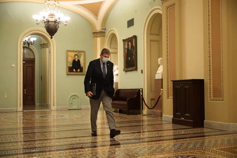 Joe Manchin leaves the Senate chamber last month.