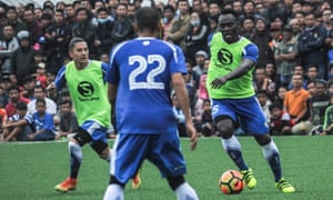Michale Essien is watched by thousands of fans during practice for Persib Bandung, where he is reportedly paid around £10,000 a week.