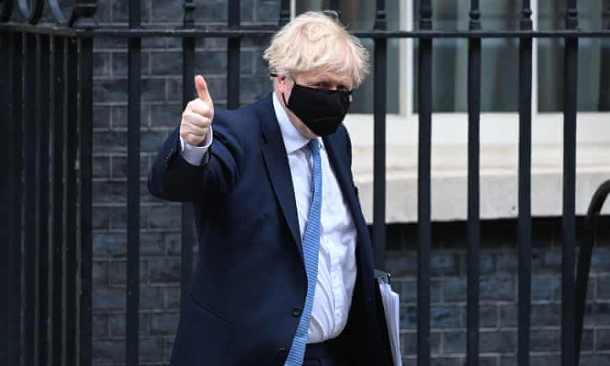 British Prime Minister Boris Johnson leaves 10 Downing Street to deliver a statement in the House of Commons on 12 May.