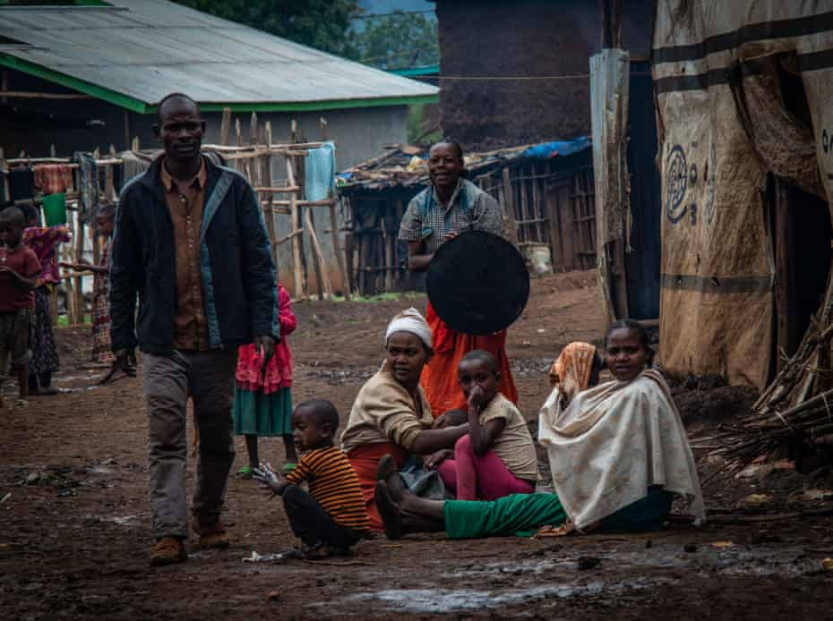 A displaced Gedeo family, outside temporary shelters in Gedeb town