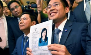 Thai Raksa Chart party leader Preechapol Pongpanich shows a document nominating Princess Ubolratana Mahidol as candidate for prime minister during election registration in Bangkok, Thailand, 8 February 2019