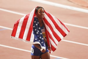 Dalilah Muhammad celebrates winning gold.