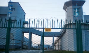 The gates and guard towers of a re-education camp