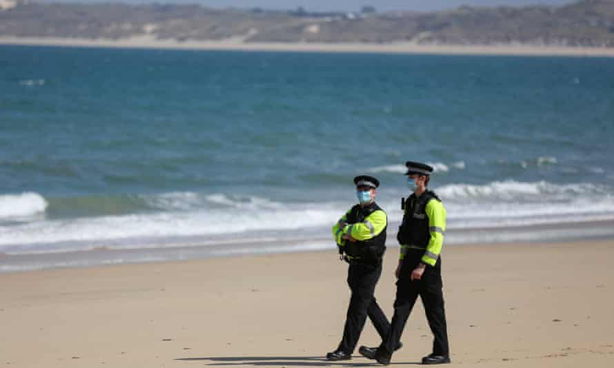 Police patrolling the beach at Carbis Bay last month.