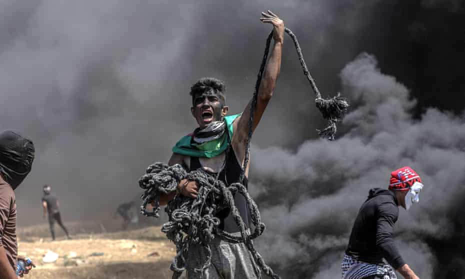 Israel's rain of bullets on Palestinian protestors 'a murderous metaphor for a divided age'.